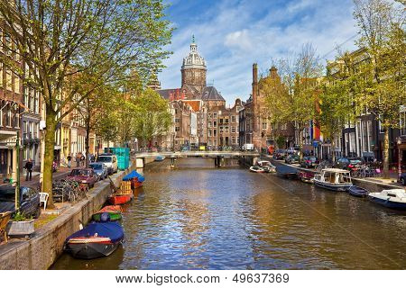 Amsterdam canals in sunny autumn weather