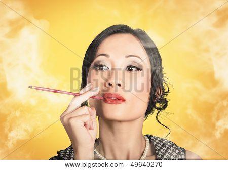 Beautiful Reto Lady Smoking On Yellow Background