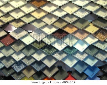 Stacked ceramic tiles of various colors and textures poster