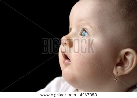 Baby Looking Up Isolated On Black Background