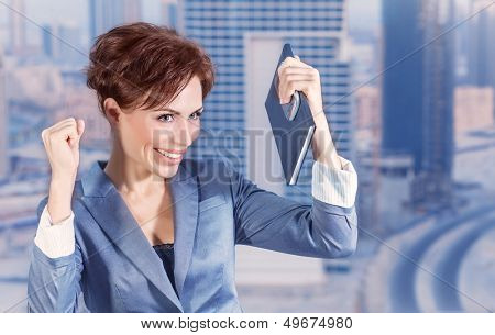Closeup portrait of attractive happy business woman on city background, successful career, done deal, executive manager, business and success concept poster