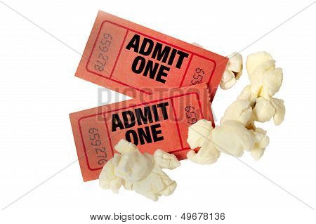 Close up shot of two red movie tickets with scattered popcorn.  Isolated on a white. poster