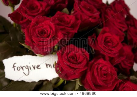 A Bunch Of Roses In Glass Vase With Note - Forgive Me