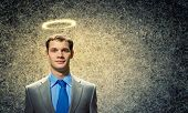 Image of businessman with halo above head poster