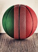 Close up of an old leather basketball with Italian flag poster