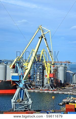 Cargo crane ship and grain dryer in port Odessa Ukraine poster