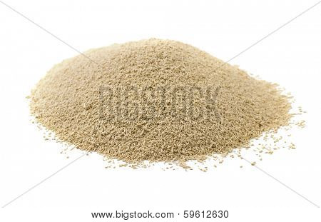 Dry yeast isolated on white