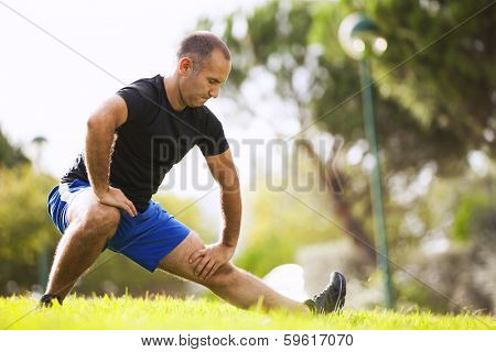 Mature man exercise in a city park