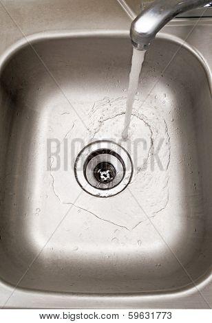 Water Running in Kitchen Sink