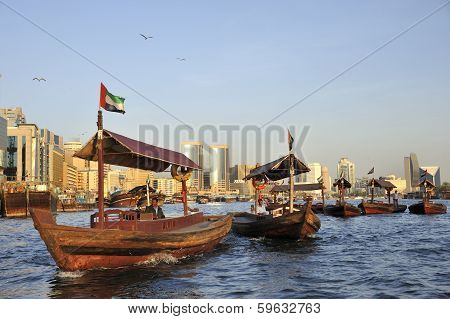 View Of Deira Quarter From Dubai Creek With Abra's Or Water Taxi's At Foreground