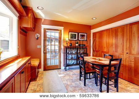 Bright Orange Dining Room With Black Wooden Table Set