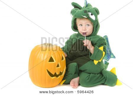 Toddler Eats Lollipop While Wearing Dragon Costume