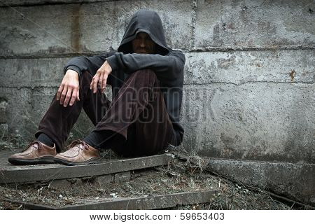 A man in a depression on the streets.