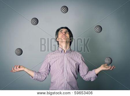 A man juggling several balls.