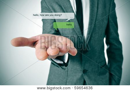 a man wearing a suit and a depiction of an instant messaging chat