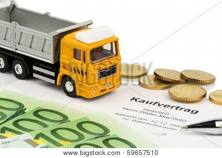 a purchase contract for new trucks. investing in new vehicles brings cost advantages.