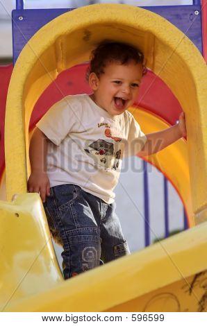 Boy Enjoys The Playground
