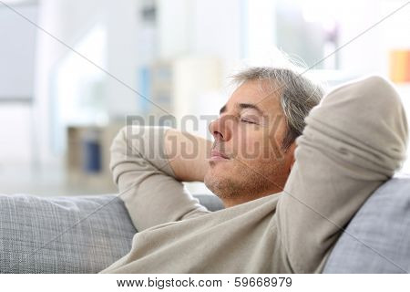 Man taking a nap in sofa at thome