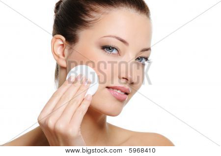 Woman Cleaning Her Face With Cotton Swab