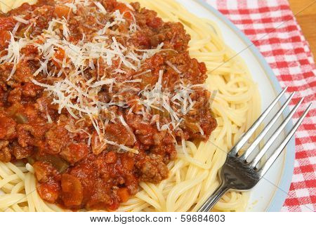 Spaghetti bolognese with shredded Parmesan cheese