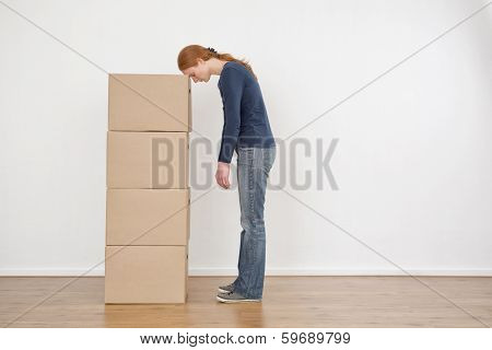 Woman Tired From Packing Boxes