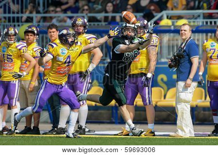 VIENNA,  AUSTRIA - APRIL 21 WR Georg Pongratz (#86 Dragons) catches the ball during the AFL football game on April 21, 2013 in Vienna, Austria.