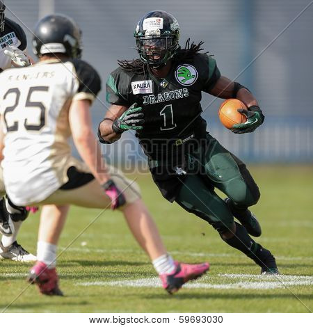 VIENNA,  AUSTRIA - APRIL 14 RB Tunde Ogun (#1 Dragons) runs with the ball during the AFL football game on April 14, 2013 in Vienna, Austria.