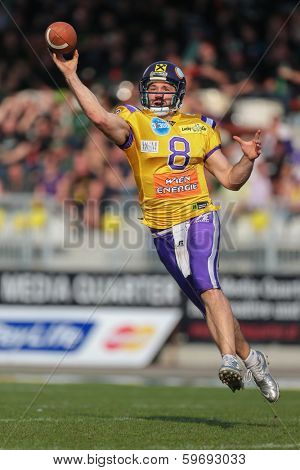 VIENNA,  AUSTRIA - APRIL 21 QB Christoph Gross (#8 Vikings) throws the ball during the AFL football game on April 21, 2013 in Vienna, Austria.
