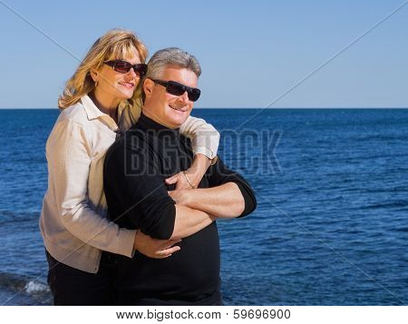 Romantic Mature Couple Relaxing At The Seaside