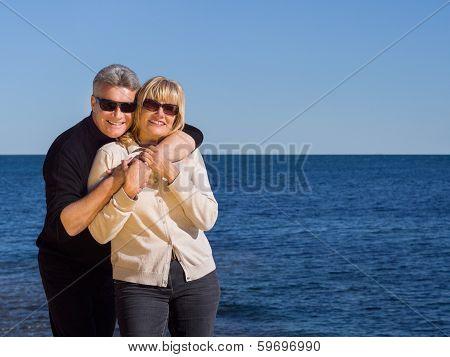 Relaxed Healthy Couple Enjoying The Coast