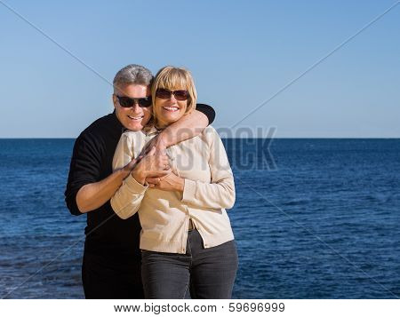 Romantic Happy Mature Couple Relaxing At The Coast