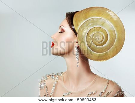 Extravagancy. Outlandish Extreme Hairstyle. Peculiar Woman With Snail As Headwear