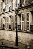 Quiet street in Montmartre, Paris in sepia poster
