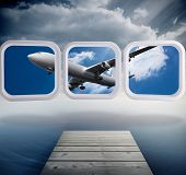 Airplane on abstract screen against cloudy sky over ocean poster