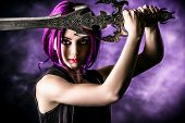 Beautiful girl warrior with a sword standing in fighting stance. Anime. Fantasy. poster