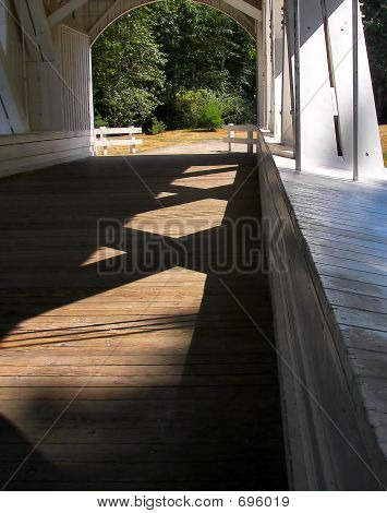 Light And Shadows On A Covered Bridge