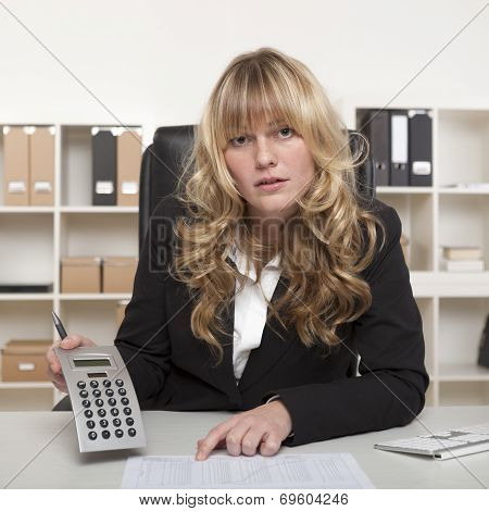 Businesswoman Questioning A Report