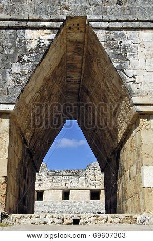 A corridor made of stone.