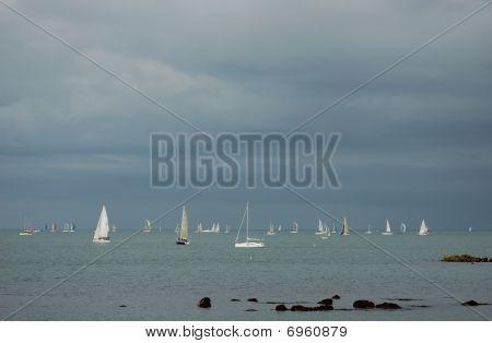 Sailboats Against A Cloudy Sky