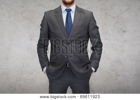 business and office concept - handsome buisnessman in suit