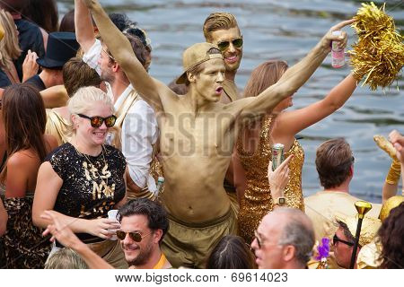 AMSTERDAM, THE NETHERLANDS - AUGUST 2, 2014: Participants at the famous Canal Parade of the Amsterdam Gay Pride 2014 on August 2, 2014 in Amsterdam