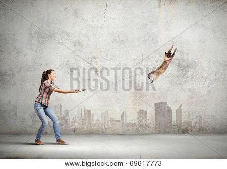 Young woman in casual and cat on lead poster