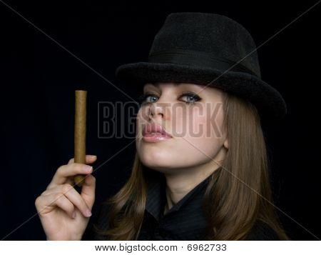 Woman In Black With A Cigarette In A Hand