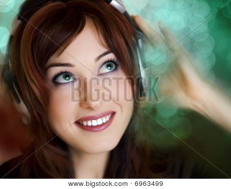 Attractive Young Woman Listening Music In Bokeh Background