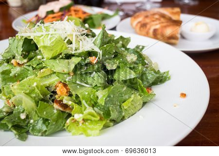 Closed Up Caesar Salad Served On Wooden Table