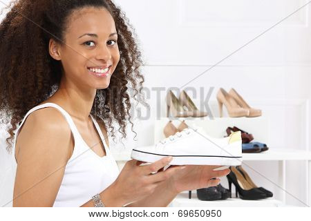 Women buy shoes at a shoe store, mulatto and Caucasian poster