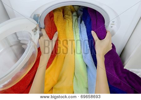 Woman Taking Color  Clothes From Washing Machine
