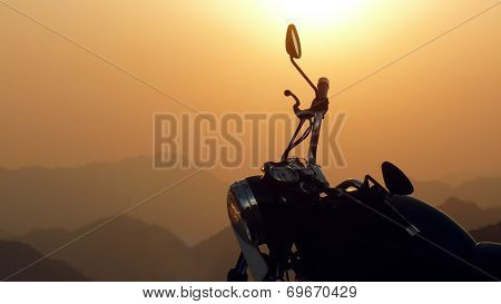 Black Royal Enfield Motorcycle In The Sunset Himalayas In India