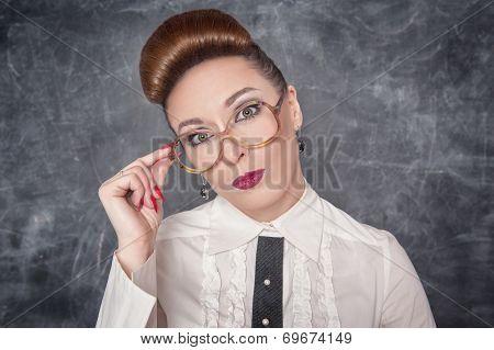 Strict Teacher In Eyeglasses Looking On Someone