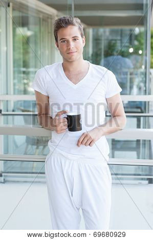 Young Adult Holding A Cup Of Coffee